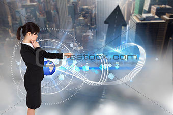 Composite image of businesswoman pointing
