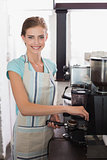 Smiling female barista preparing espresso at coffee shop