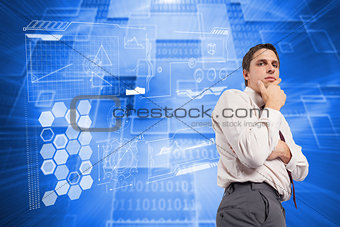 Composite image of thoughtful businessman with hand on chin