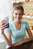Smiling woman with coffee sipper in coffee shop