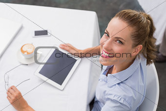 Woman using digital tablet in coffee shop