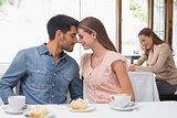 Romantic couple having coffee at coffee shop