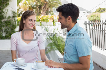 Romantic young couple at coffee shop