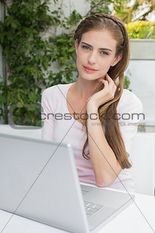 Beautiful woman using laptop at café