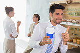 Businessman with coffee sipper at counter in office cafeteria