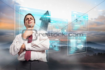 Composite image of thoughtful businessman holding pen to chin