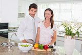 Portrait of happy young couple in the kitchen