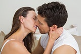 Loving young couple about to kiss