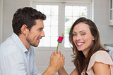 Man giving happy woman a rose