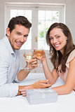 Portrait of a loving couple toasting wine glasses