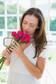 Beautiful woman with flowers at home