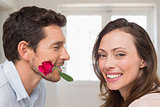 Loving couple with a rose at home