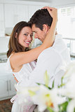 Portrait of a loving young couple in kitchen