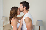 Loving young man kissing woman on forehead