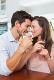 Loving couple with wine glasses at home