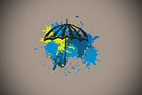 Composite image of umbrella on paint splashes