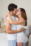 Loving young couple about to kiss at home