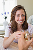 Smiling young woman toasting wine glass
