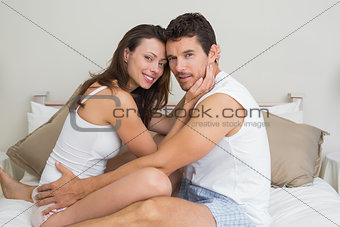 Portrait of a loving couple sitting in bed
