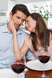Couple with wine glasses at dining table