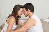 Loving couple with eyes closed at home