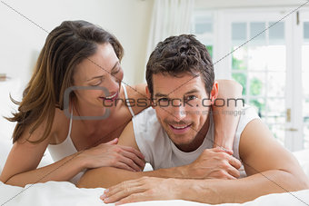 Portrait of a relaxed couple lying in bed