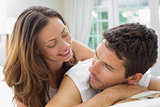 Close-up of a relaxed couple lying in bed