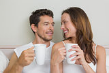 Happy relaxed couple with coffee cups