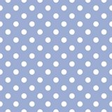 Seamless vector pattern with white polka dots on a pastel blue background.