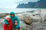 Family near summer Senja coast (Jagged Ersfjord, Norway, polar d