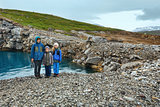 Family near reservoir Storglomvatnet (Meloy, Norge)