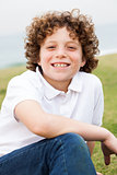 Smiling young boy posing casually