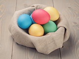 Easter eggs in nest from sack textile rustic style