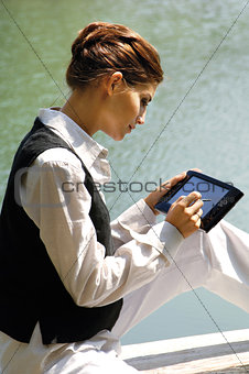 business woman with laptop at the sea