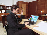 businessman with laptop in office l