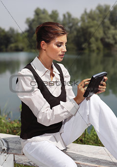 a woman with laptop in park cvb