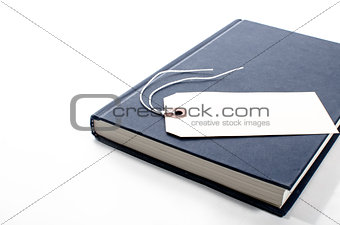 A book with a blank tag