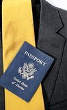 Passport laying on suit and lie.