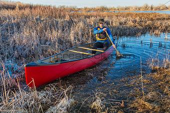canoe paddling through a swamp