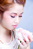 beautiful young woman with jewellery and rose