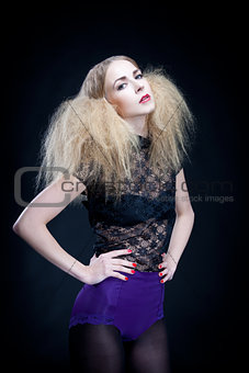 attractive blonde woman with big hair and modern styling
