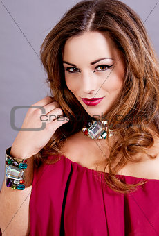 attractive brunette woman with glamour jewellry