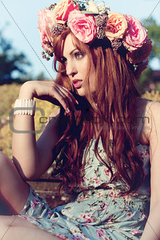 beautfiul woman outdoor in summer with flowers on head