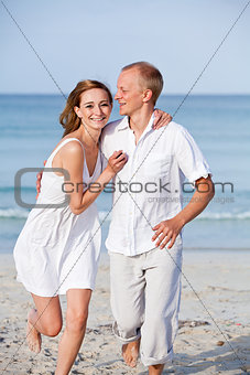 happy couple in love having fun on the beach