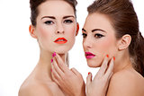 two beautiful girls with colorfull makeup isolated