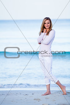 attractive young blonde woman relaxing on the beach