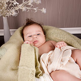 sweet little baby infant toddler on blanket in basket