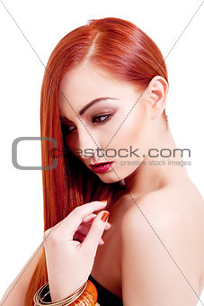 attractive young woman with shiny red hair and makeup