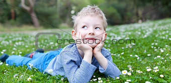 child lying at grass