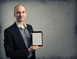 Business man holding digital tablet PC with blank screen